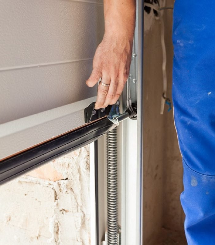 How to do Garage door hinge repair?