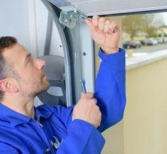 How to do Garage door hinge repair?